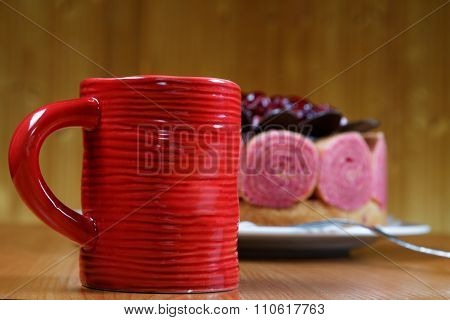Cake With A Cup Of Coffee On The Table