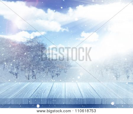 3D render of a wooden table against a defocussed snowy landscape