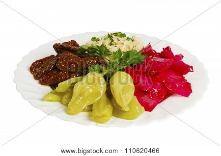 different colored pickles on the plate, isolated
