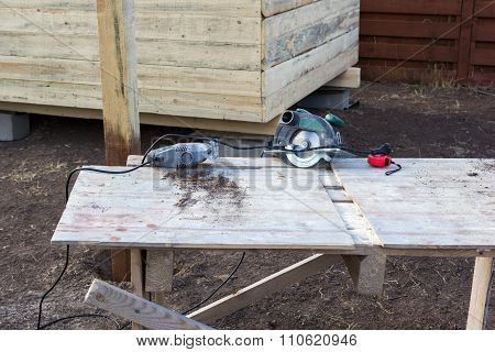 Jigsaw And Circular Saw On Workbench