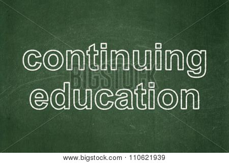 Studying concept: Continuing Education on chalkboard background
