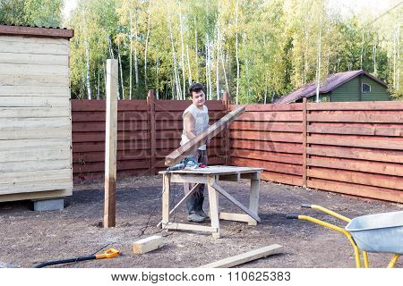 Man Puts Wooden Beam On The Bench