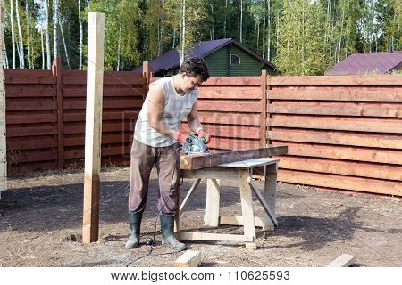 Man Cut Wooden Beam With Circular Saw