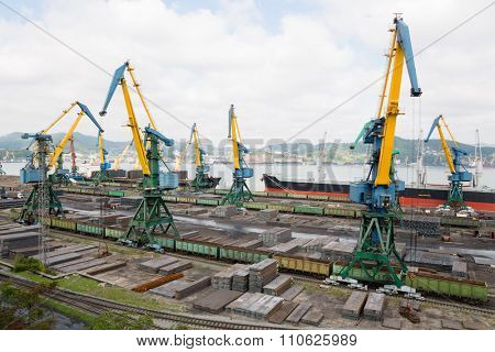 Cargo handling of metal on a ship in port of Nakhodka, Russia.