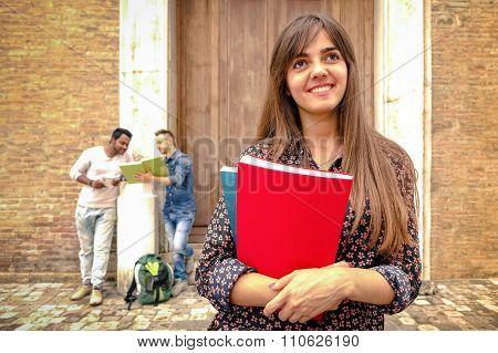 Pretty Woman walking student Holding Books