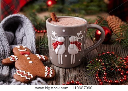 Cup of hot chocolate or cocoa with two cute deer, cinnamon and gingerbread man cookie in new year tr