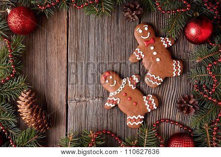 Gingerbread man and woman couple cookies christmas composition in new year tree decorations frame on
