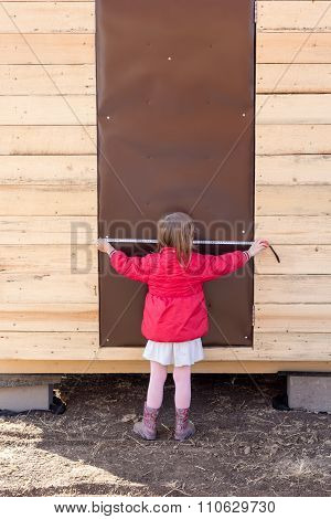 Little Girl Measures The Door With Tape Measure