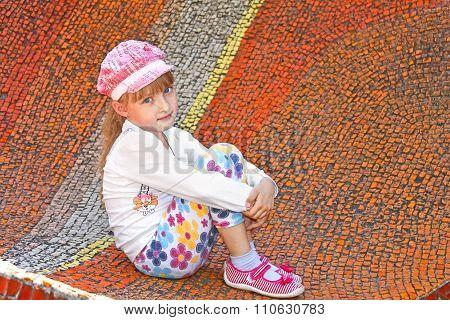 Little Girl Sitting On The Big Mosaic Panel