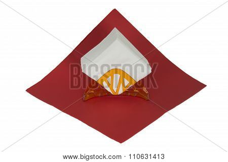 A Stack Of White Napkins On A Red Napkin