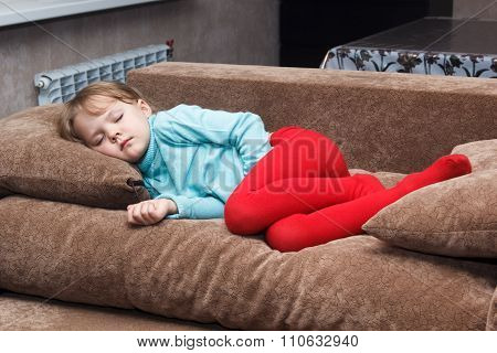 Little Girl Sleeps Like A Top On Couch
