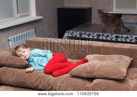 Cat Watches Little Girl Sleeps Like A Top On Couch