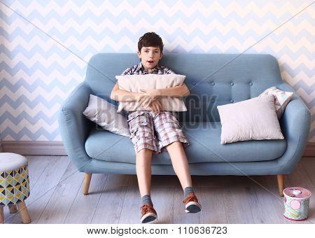 preteen boy in cozy bedroom interior