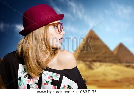 Charming girl in hipster glasses on sunny Egypt pyramid background
