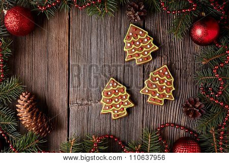 Gingerbread fur trees cookies christmas composition in new year tree decorations frame on vintage wo