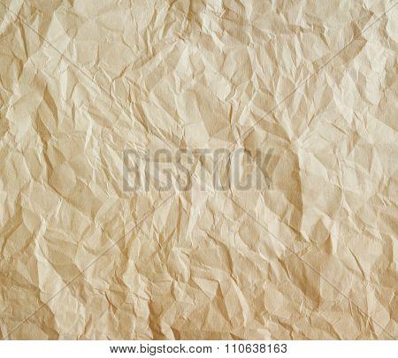 Crumpled Beige parchment Background.