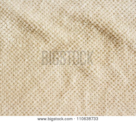 Beige carpet background crumpled close-up.