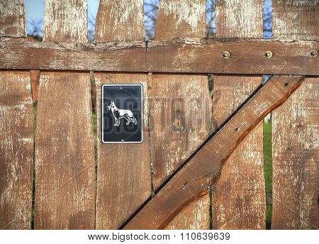 Beware Of Dog Sign On Wooden Door