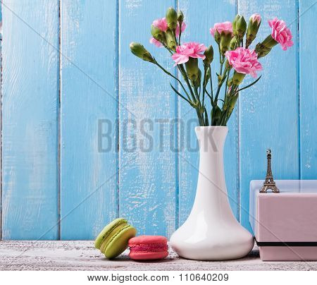Pink Flowers In The Vase, Macarons And Souvenir Eiffel Tower