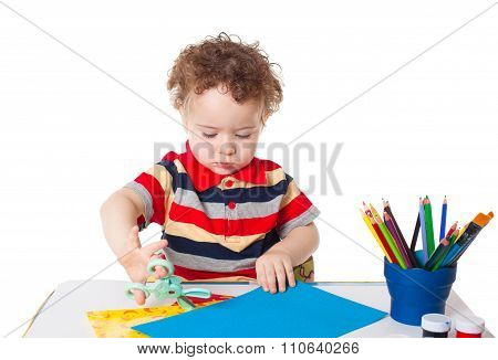 Cute Happy Baby Boy Cutting Colorful Paper
