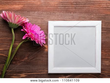 Gerbera Flowers And Empty Frame On The Wooden Background