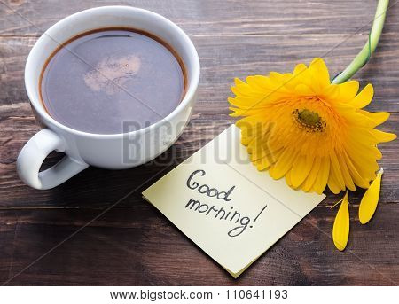 Cup Of Coffee, Yellow Gerbera Flower And Paper With Text
