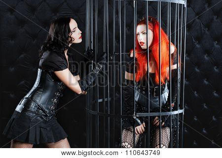 Girls Mistress Dominates Another Girl Who Is Locked  Cage.