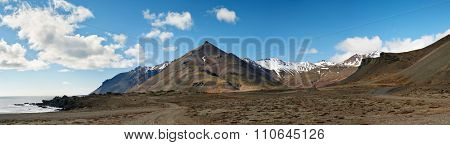 Beautiful stunning dramatic snowcapped mountain and vast icelandic landscape, sunny day with blue skies