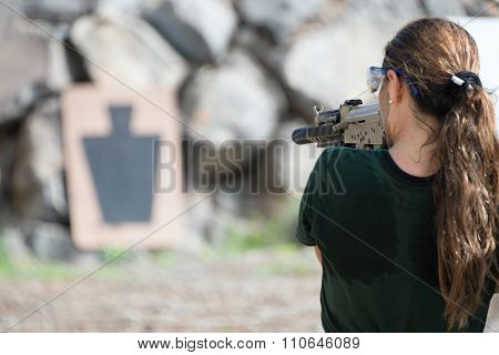 Young women training with gun