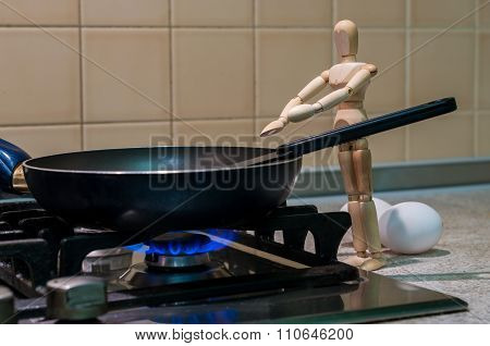 Wooden dummy, mannequin or man figurine cooking at kitchen, stand near pan. Cooking illustration