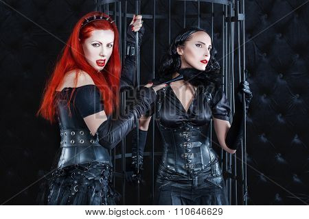 Women Dressed In Latex And Leather Dominate The Game Play.