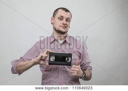 Man with video cassette