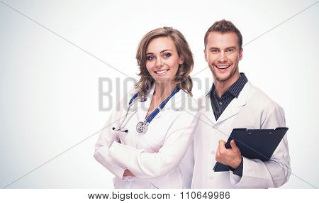 Friendly Smiling Male and Female Doctors