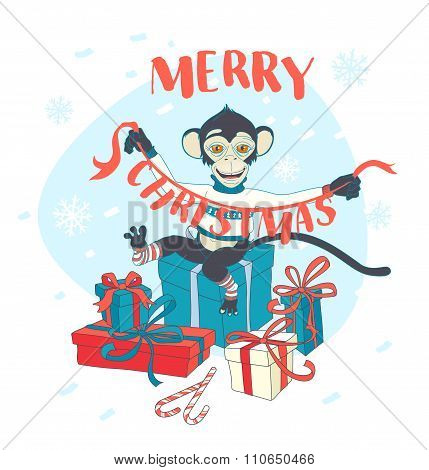 Cute monkey holding Christmas garland sitting on presents