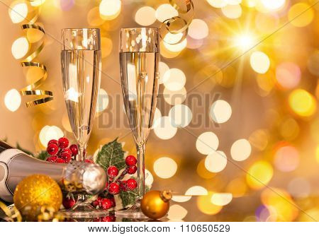 Glasses of champagne with bright gold background