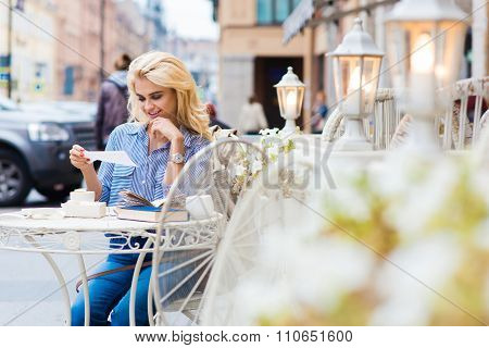 Amazing female student relaxing in coffee shop after lectures in University