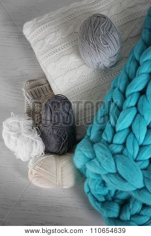 Knitted wool plaid  and clothes on light background