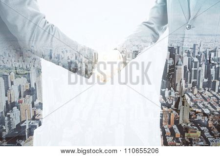 Double Explosure With Businessmen Handshake And City View With Skyscrapers