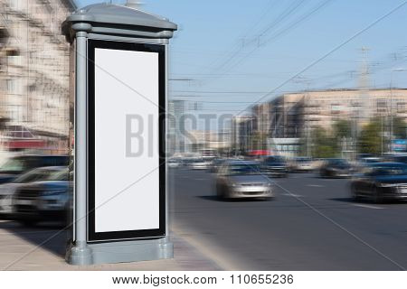 White advertising mock up banner in metropolitan city in daytime