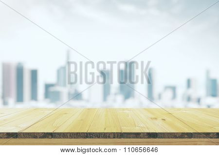 Empty Wooden Table With A Blurred Background Of The City