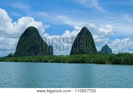 Cliffs Along The Bay Surrounded By Islands With Mangroves. Islands At Phang Nga Bay Near Krabi And P