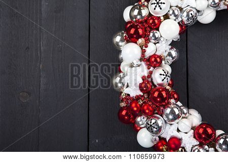 Christmas Wreath With Bells On Dark Wooden Background