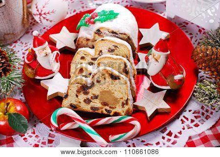 Sliced Christmas Stollen Cake On Red Plate