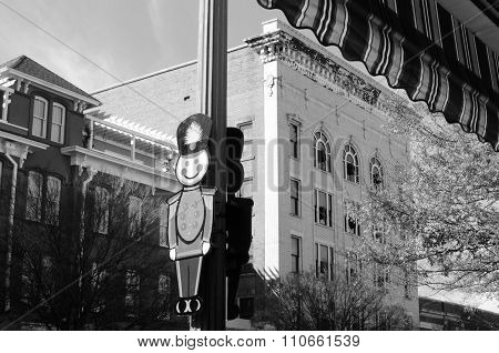 Toy soldier decorating a town light post