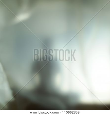 Blurred silhouette of human spirit against light