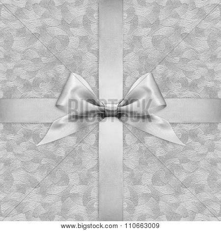 Shiny Silver Satin Ribbon Bow On Argent Background
