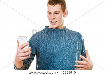 Surprised Young Man Looking At Mobile Phone