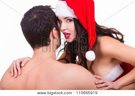 Young seductive female flirting with man. Sexy girl in Santa costume seduction.