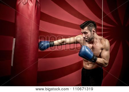 professional boxing training with muscular athletic man. Active boxer in gym