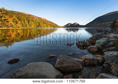 Mountain Lake in Early Autumn Sunlight